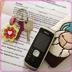 Schlüssel. Handy, OGS-Vereinbarung